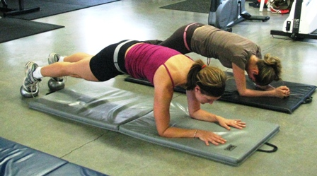 plank, working out in a gym in Coombs